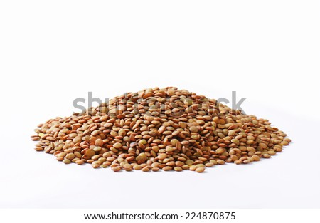 Pile of dried brown lentils - stock photo