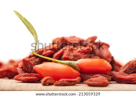 pile of dry and fresh goji berry on white background - stock photo