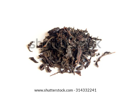 Pile of dry black tea isolated on white background