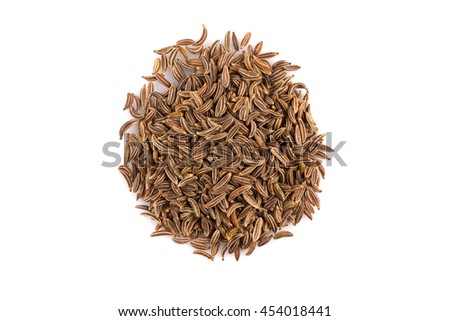 Pile of dry caraway seeds Isolated on white background