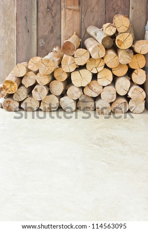Pile of  dry firewood on the ground with copy space. - stock photo