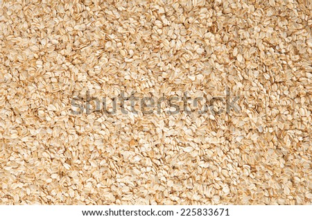 Pile of dry oat flakes background - stock photo
