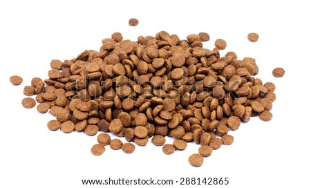 Pile of dry pet food on white background - stock photo