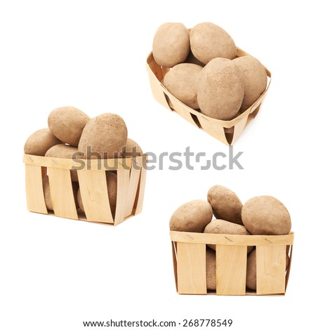 Pile of earth dirty potatoes in a wooden basket, composition isolated over the white background, set of three foreshortenings - stock photo