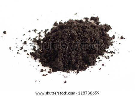 Pile of earth on a white surface, close up - stock photo