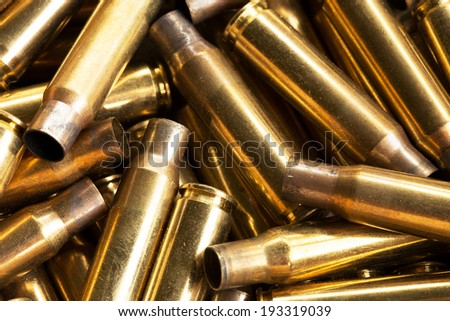 Pile of empty bullet shells . Rifle. Firearms ammunition