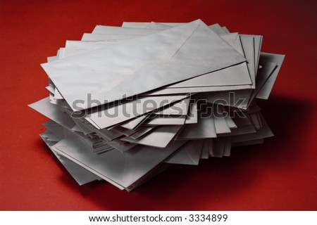 pile of envelopes over red background - stock photo
