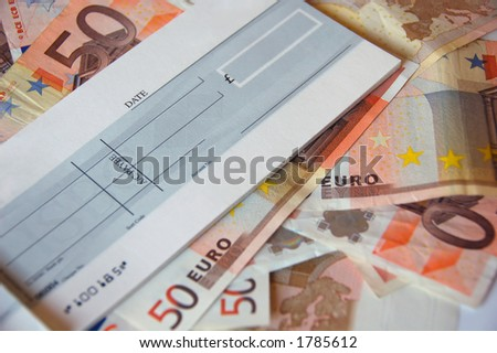 pile of euro bills under business cheque book - stock photo
