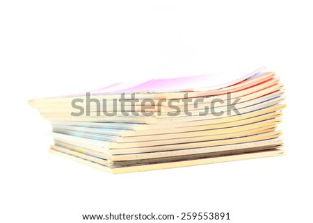 pile of exercise books on white background - stock photo