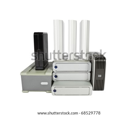 Pile of external hard drives isolated on white. - stock photo