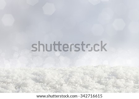 Pile of fallen snow on abstract bokeh background - stock photo