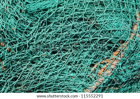 Pile of fishing nets on a quay - stock photo
