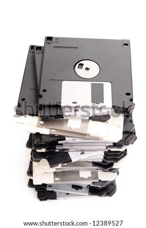 Pile of floppy disks over white - stock photo