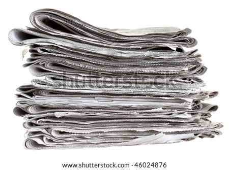 Pile of folded newspapers isolated against a white background