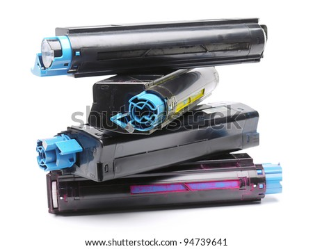 Pile of four used laser printer toner cartridges of Cyan, Magenta, Yellow and black color shot over white background - stock photo