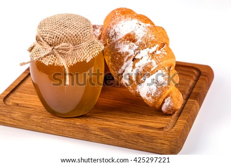 pile of fresh and delicious kroissants and rolls on a white background