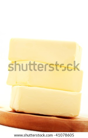 pile of fresh butter - food and drink