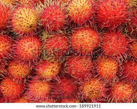 Pile of fresh rambutan fruit  - stock photo