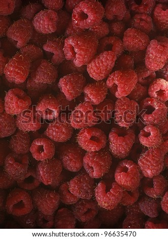 Pile of fresh rapsberries. - stock photo