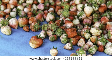Pile of fresh ripe strawberries at market