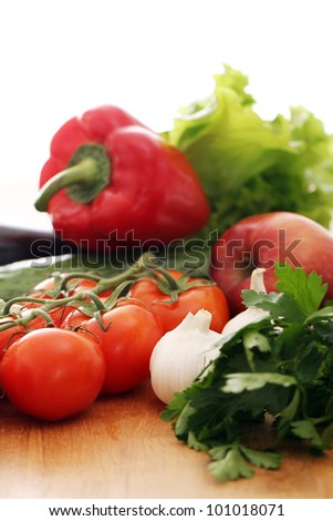 Pile of fresh vegetables  on wooden surface