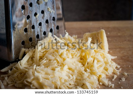 Pile of freshly grated cheese - stock photo