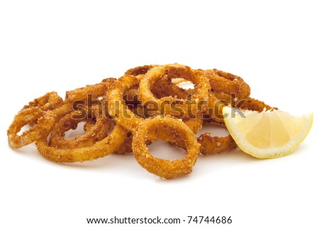Pile of fried onion rings with a lemon wedge, over white background. - stock photo