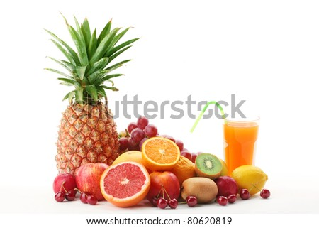 Pile of fruits with fruit juice on a white background. - stock photo
