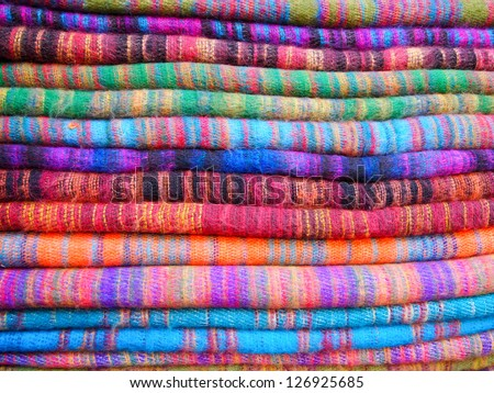 Pile of gentle folded shawls (scarfs) at the market