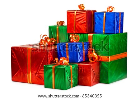 Pile of gift boxes of various sizes and colors. Isolated on white background. - stock photo