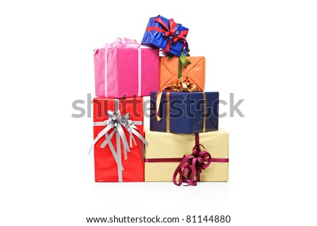 Pile of gift boxes of various sizes and colors isolated on white background - stock photo