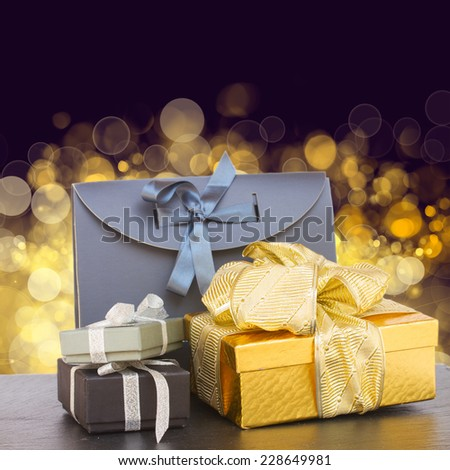pile of  gift boxes  on shinig bokeh background - stock photo