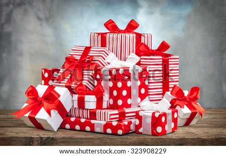 pile of gifts on the old table. - stock photo