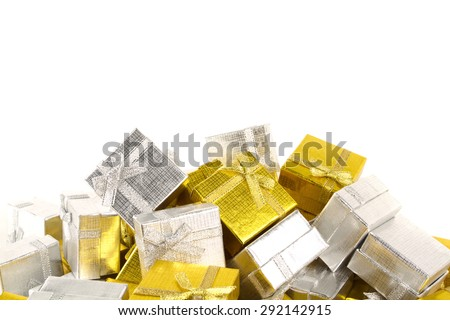 Pile of gold and silver gifts on white background - stock photo