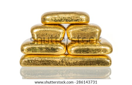 pile of  gold bullion with shadow isolated on white - stock photo