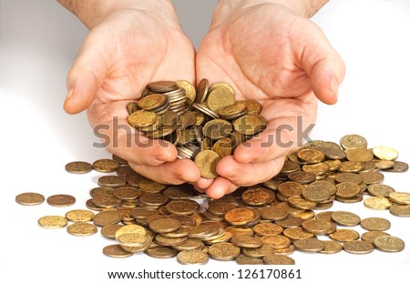 pile of gold coins on the table. wealth luck risk. - stock photo