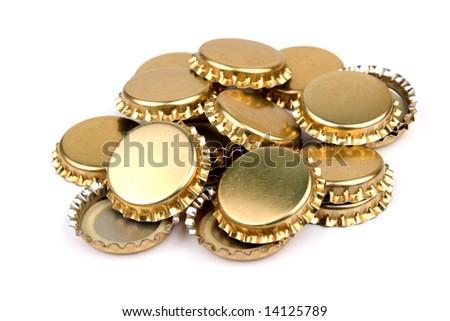 Pile of golden bottle caps - stock photo