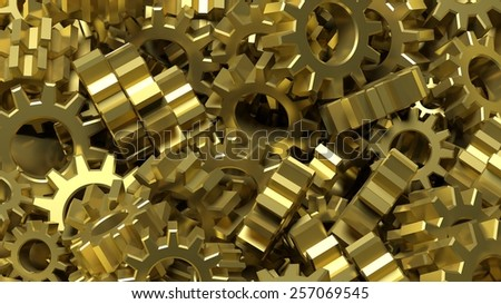 Pile of golden cogwheels abstract conceptual background  - stock photo