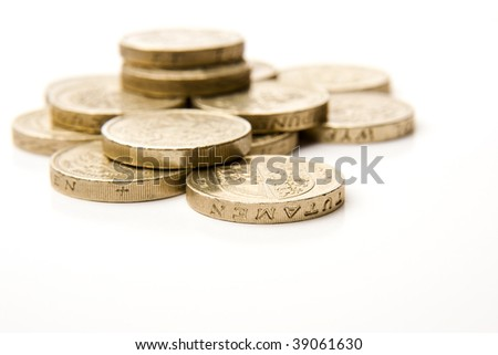 Pile of golden coins, shallow DOF, Focus on closest coin - stock photo