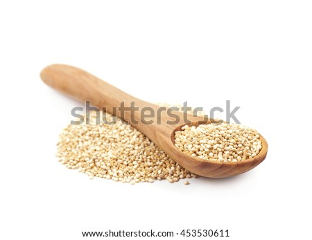 Pile of grain quinoa seeds isolated over the white background - stock photo