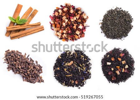 Pile of green and black tea leaves isolated on white background. mint, cinnamon and carnation
