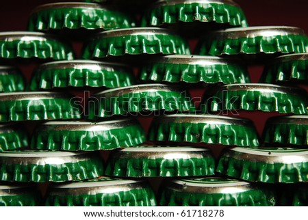 pile of green beer caps close up good for background - stock photo