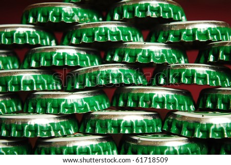 pile of green beer caps close up good for background