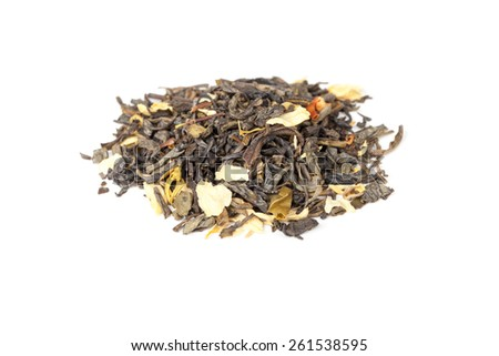 Pile of green Chinese tea with jasmine petals isolated on white background, selective focus with shallow DOF - stock photo