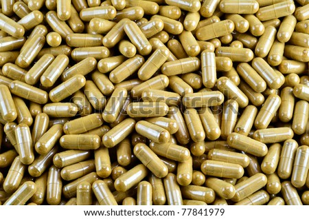 Pile Of Green Herb Capsule, Dried Cinnamon's Bark - stock photo