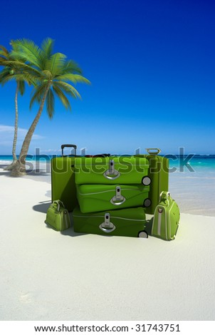 Pile of green luggage on a tropical beach - stock photo