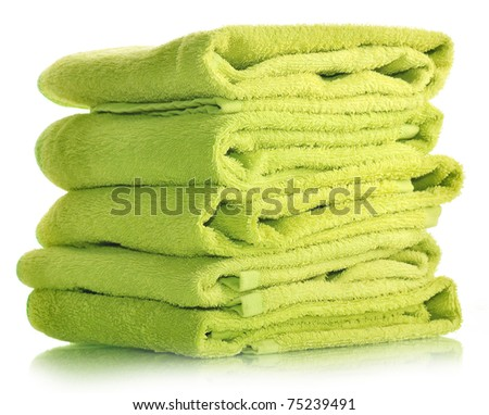 Pile of green towels on a white insulated background