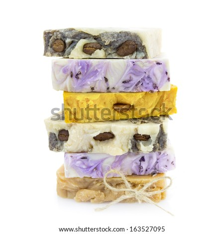 Pile of handmade natural colorful soap on white background - stock photo