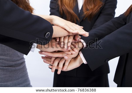 pile of hands of business people