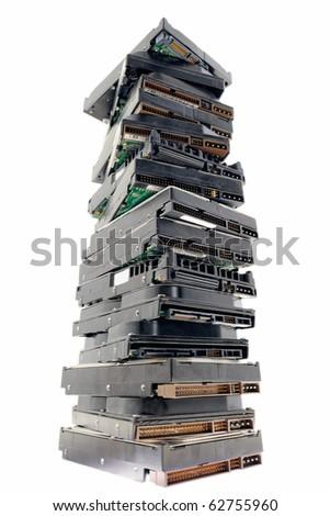 Pile of hard discs on the white background - stock photo